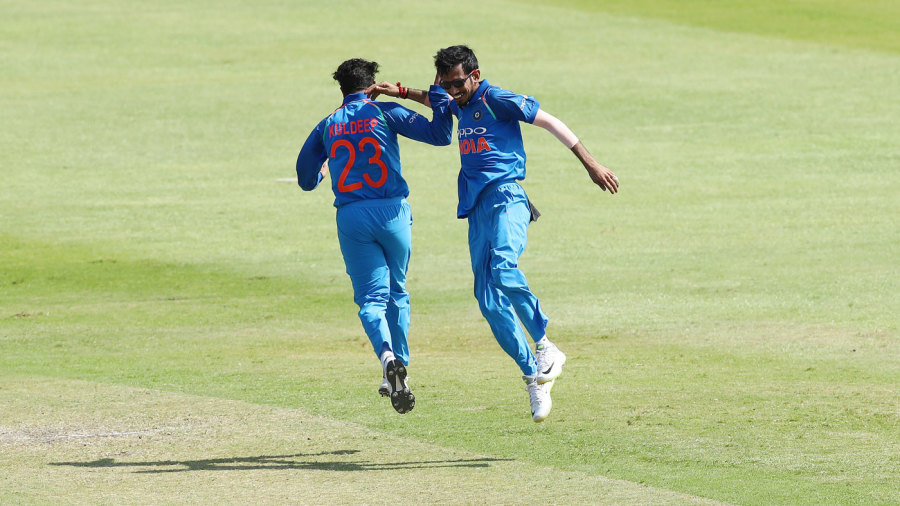 Yuzvendra Chahal and Kuldeep Yadav celebrate a wicket