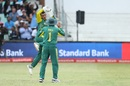 Quinton de Kock is midway through clicking his heels in celebration, South Africa v India, 1st ODI, Durban, February 1, 2018