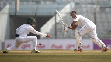 Dinesh Chandimal tucks the ball past short leg