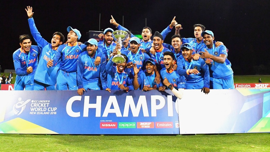 The victorious Indian team celebrate with the trophy
