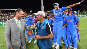 Prithvi Shaw and his team-mates celebrate as Rahul Dravid is interviewed