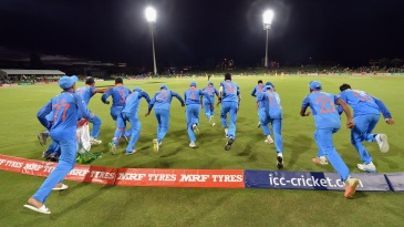 India players run onto the field to celebrate