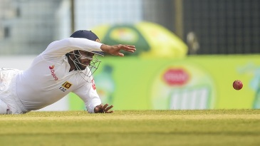 Kusal Mendis reaches out for the ball