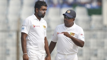 Dilruwan Perera and Rangana Herath have a chat