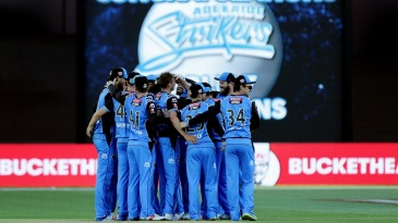 The Strikers gather into a huddle to celebrate their first BBL title win