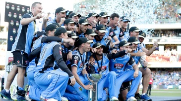 The Strikers celebrate with the BBL trophy