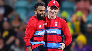 Adil Rashid gets a pat on the back from his captain