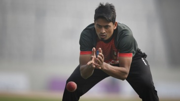 Taijul Islam catches the ball at training