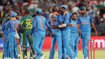 India celebrate their 124-run win in Cape Town