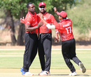 Dilon Heyliger gets hugs from Ruvindu Gunasekera and Bhavindu Adhihetty after taking his first wicket, Canada v Oman, ICC World Cricket League Division Two, Windhoek, February 8, 2018