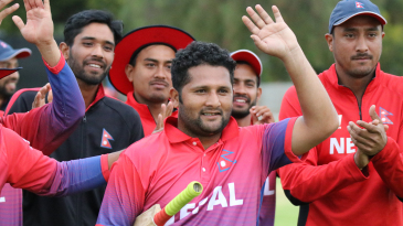 Basant Regmi walks off to applause from his team-mates after his 24 not out secured victory