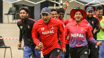 Captain Paras Khadka leads the celebratory charge after Nepal clinched a dramatic win
