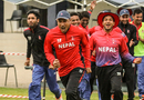 Captain Paras Khadka leads the celebratory charge after Nepal clinched a dramatic win, Namibia v Nepal, ICC World Cricket League Division Two, Windhoek, February 8, 2018