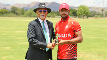 Nikhil Dutta accepts the Man of the Match award from ICC match referee Dev Govindjee