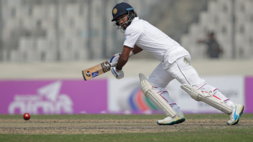 Dimuth Karunaratne steers one through the off side