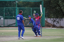 Basant Regmi raises his arms aloft after a leg-side wide clinches a one-wicket win, Namibia v Nepal, ICC World Cricket League Division Two, Windhoek, February 8, 2018