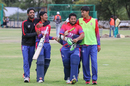 Sandeep Lamichhane and Basant Regmi are embraced by team-mates after their last-wicket stand clinched a one-wicket win, Namibia v Nepal, ICC World Cricket League Division Two, Windhoek, February 8, 2018
