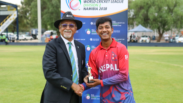 Sandeep Lamichhane receives his Man of the Match award from ICC match referee Dev Govindjee