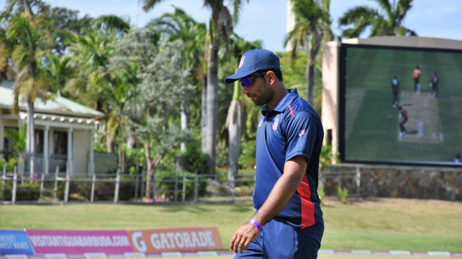 Saurabh Netravalkar walks back to his fielding position
