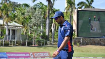Saurabh Netravalkar walks back to his fielding position