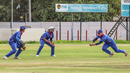 Stephan Baard moves right to take a sharp low catch at gully for another Sarel Burger wicket, Namibia v Oman, ICC World Cricket League Division Two, Windhoek, February 11, 2018