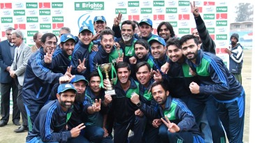 The Karachi Whites players celebrate their victory