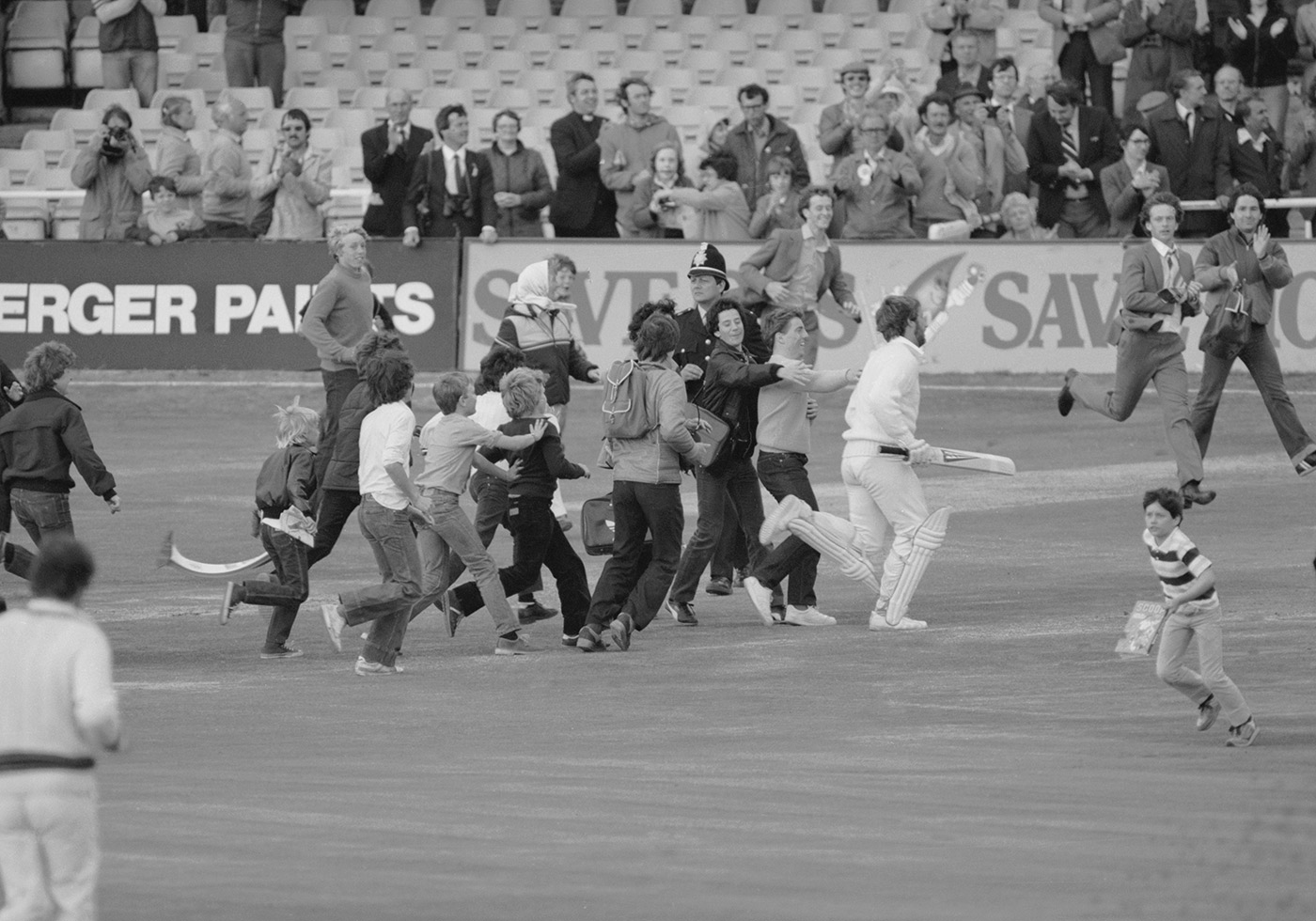 That's me done: Botham exits stage right, pursued by a mob of children at the end of day four at Headingly in 1981