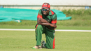 Shem Ngoche kneels alone on the outfield after misfielding the final ball of the match, Kenya v Nepal, ICC World Cricket League Division Two, Windhoek, February 12, 2018