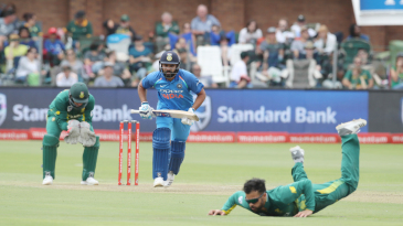 Rohit Sharma sets off for a run as JP Duminy fails to stop a ball off his own bowling