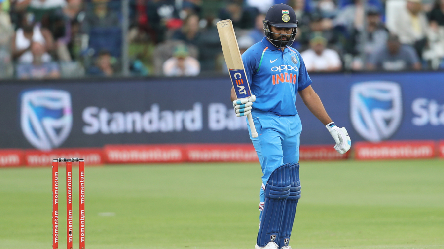 Rohit Sharma raises his bat after getting to his century