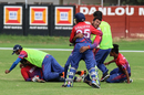 Team-mates stormed the pitch to tackle Karan KC and embrace Sandeep Lamichhane after the winning run, Canada v Nepal, ICC World Cricket League Division Two, Windhoek, February 14, 2018