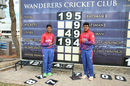 Sandeep Lamichhane and Karan KC pose with the Wanderers scoreboard after their miracle stand, Canada v Nepal, ICC World Cricket League Division Two, Windhoek, February 14, 2018