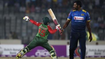 Thisara Perera looks an as Mushfiqur Rahim celebrates his second T20I fifty