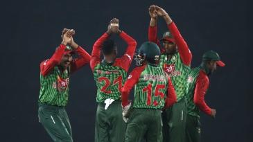 Nazmul Islam celebrates a wicket