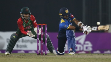 Dasun Shanaka sweeps towards the leg side