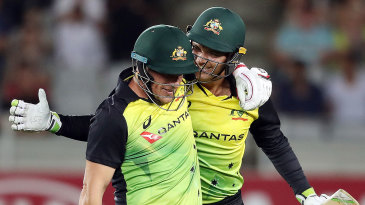 Aaron Finch and Alex Carey celebrate Australia's record-breaking win