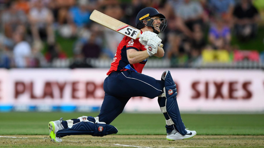 Eoin Morgan launches a slog-sweep on his way to fifty