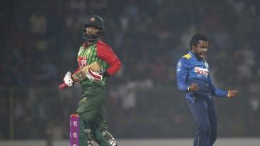 Amila Aponso celebrates the wicket of Tamim Iqbal