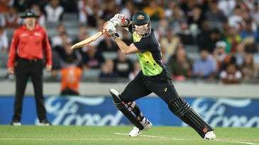 David Warner drives through the covers