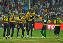 Mohammad Irfan is mobbed by his team-mates upon picking up a wicket, Peshawar Zalmi v Multan Sultans, PSL 2018, Dubai, February 22, 2018