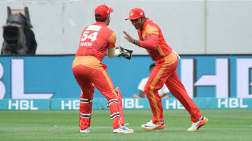 Asif Ali is congratulated by Luke Rochi upon catching Kumar Sangakkara
