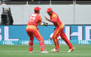 Asif Ali is congratulated by Luke Rochi upon catching Kumar Sangakkara, Multan Sultans v Islamabad United, PSL 2018, Dubai, February 25, 2018