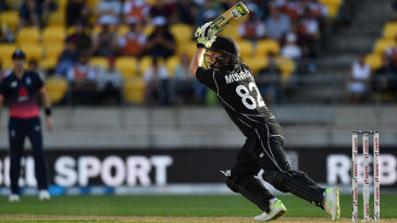 Colin Munro drives through the covers