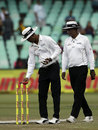 Umpire Kumar Dharmasena checks the reading on a light meter, South Africa v Australia, 1st Test, Durban, 3rd day, March 3, 2018