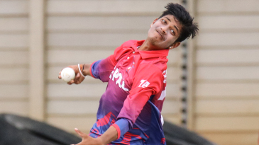 Sandeep Lamichhane bowls during his opening spell