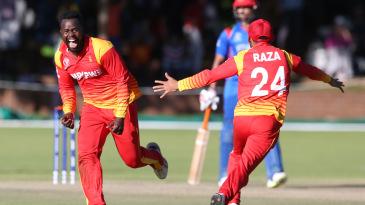 Brian Vitori and Sikandar Raza rejoice at the fall of the final wicket