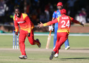 Brian Vitori and Sikandar Raza rejoice at the fall of the final wicket, Zimbabwe v Afghanistan, Bulawayo, March 6, 2018