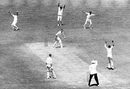 Alan Davidson is caught behind by Gerry Alexander off Garry Sobers while Richie Benaud watches from  the non-striker's end, Australia v West Indies, 5th Test, Melbourne, 3rd day, February 13, 1961