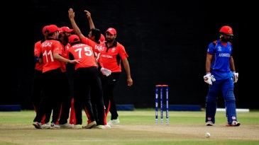 Hong Kong gather around wicket-taker Ehsan Khan