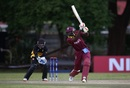 Jason Holder unfurls a languid drive, Papua New Guinea v West Indies, World Cup Qualifier, Harare, March 8, 2018